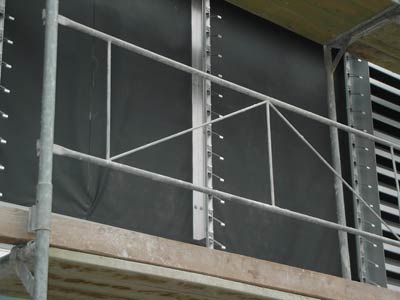 Polyacryl-Fassadenmembran, Stamisol FI, Vorhangfassade, geschlossene Fassade, leicht geöffnete hinterlüftete Fassaden, Bautechnik, vorgehängte Fassade, diffusionsoffen, Schwerentflammbarkeit, Öko-Tex, Diffusionsoffenheit, Atmungsaktivität