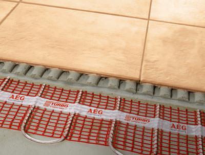 elektrische Fußbodenheizung, AEG Thermoboden, Heizmatte, eingenähte Heizleiter, Fußbodenheizung, AEG Haustechnik, eingenähter Heizleiter, Fliesenkleber, Aufbauhöhe