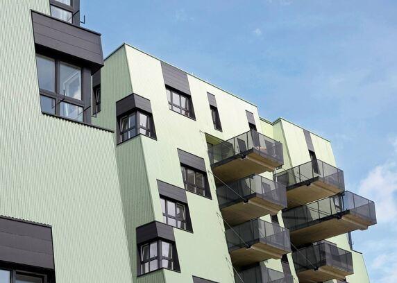 Wohnanlage Ville Verdi in Wien mit Rollprofilen aus Stahl in der Fassade.